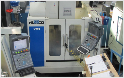 Here is a photo of our 3 Axis Hurco Milling Machine